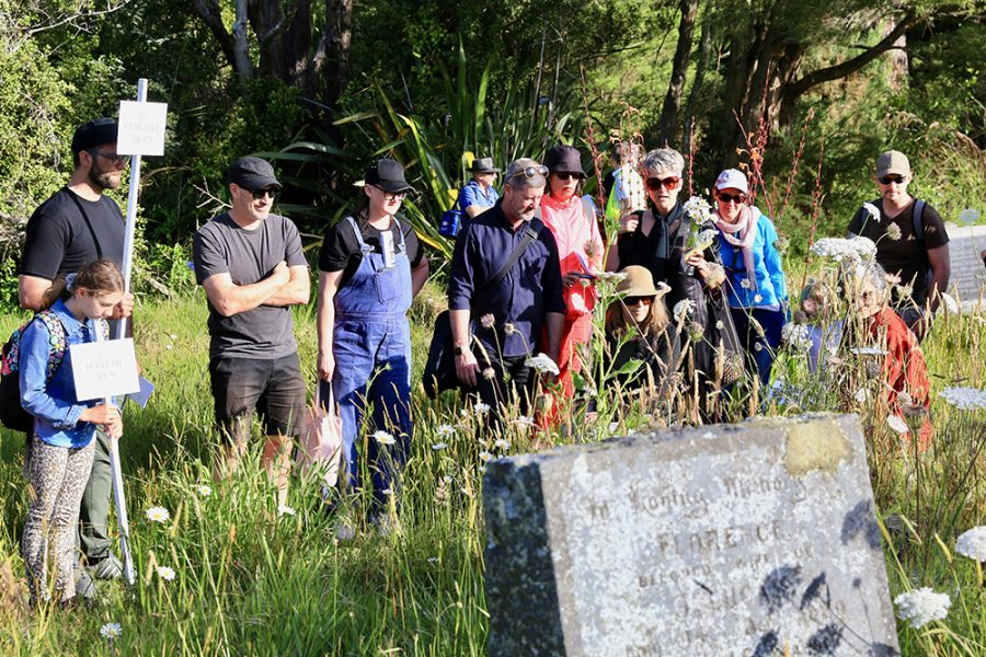 Group looking at headstone, Wayfinding Waikumete